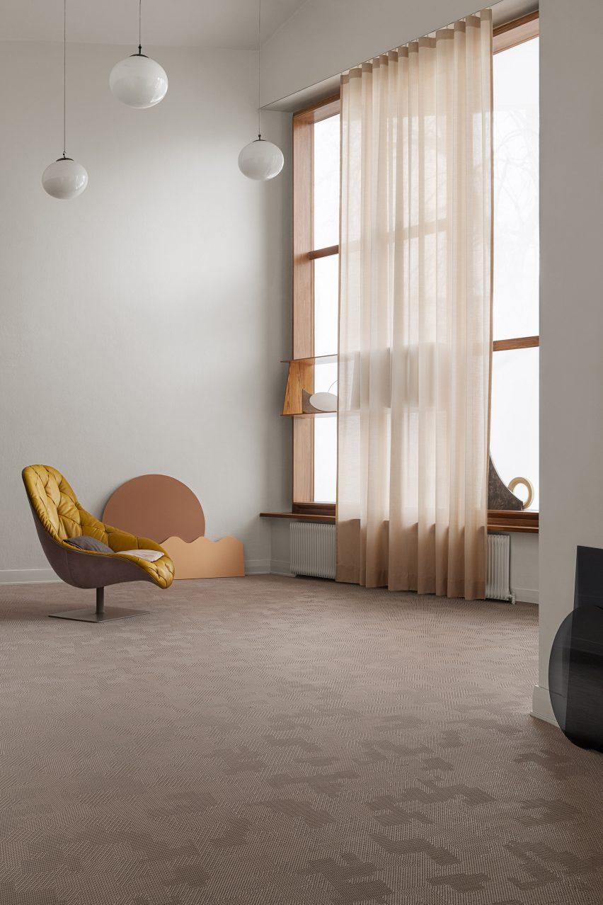 A yellow chair on Bolon flooring