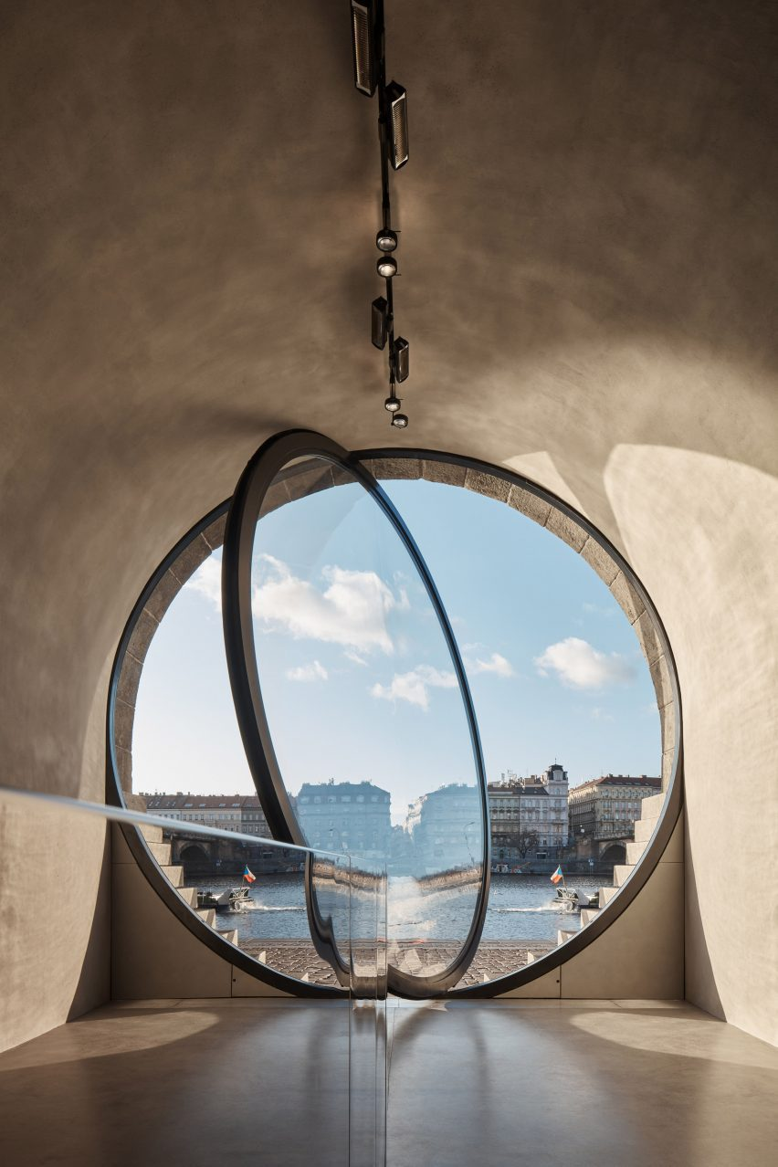 The circular window is pivoted to open