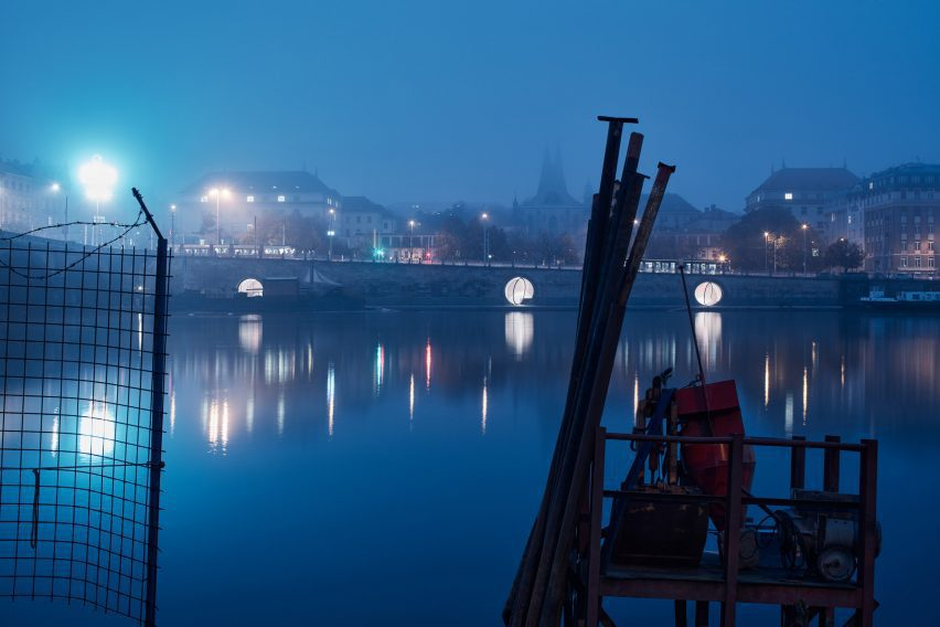 The Prague waterfront is illuminated by the public space