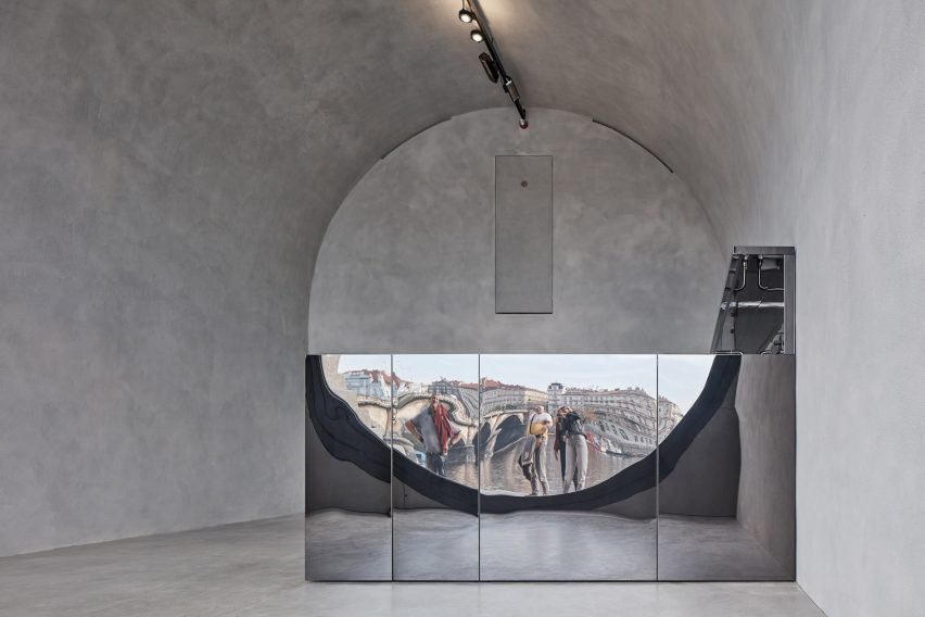 A mirrored counter reflects the prague waterfront
