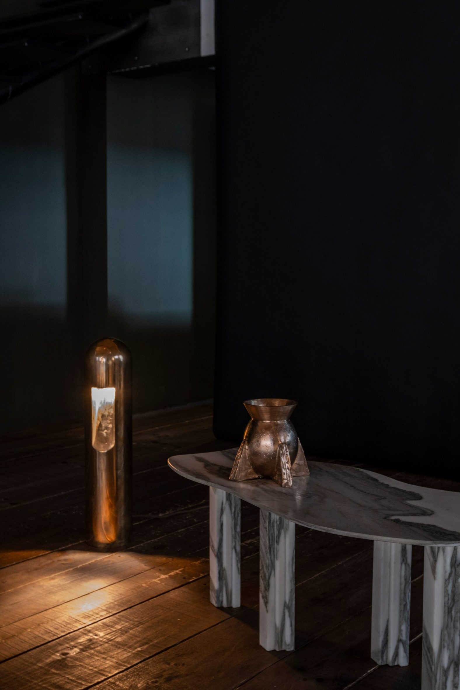 Marble table by Lorenzo Bini with bronze lamp and vessle by Rick Owens