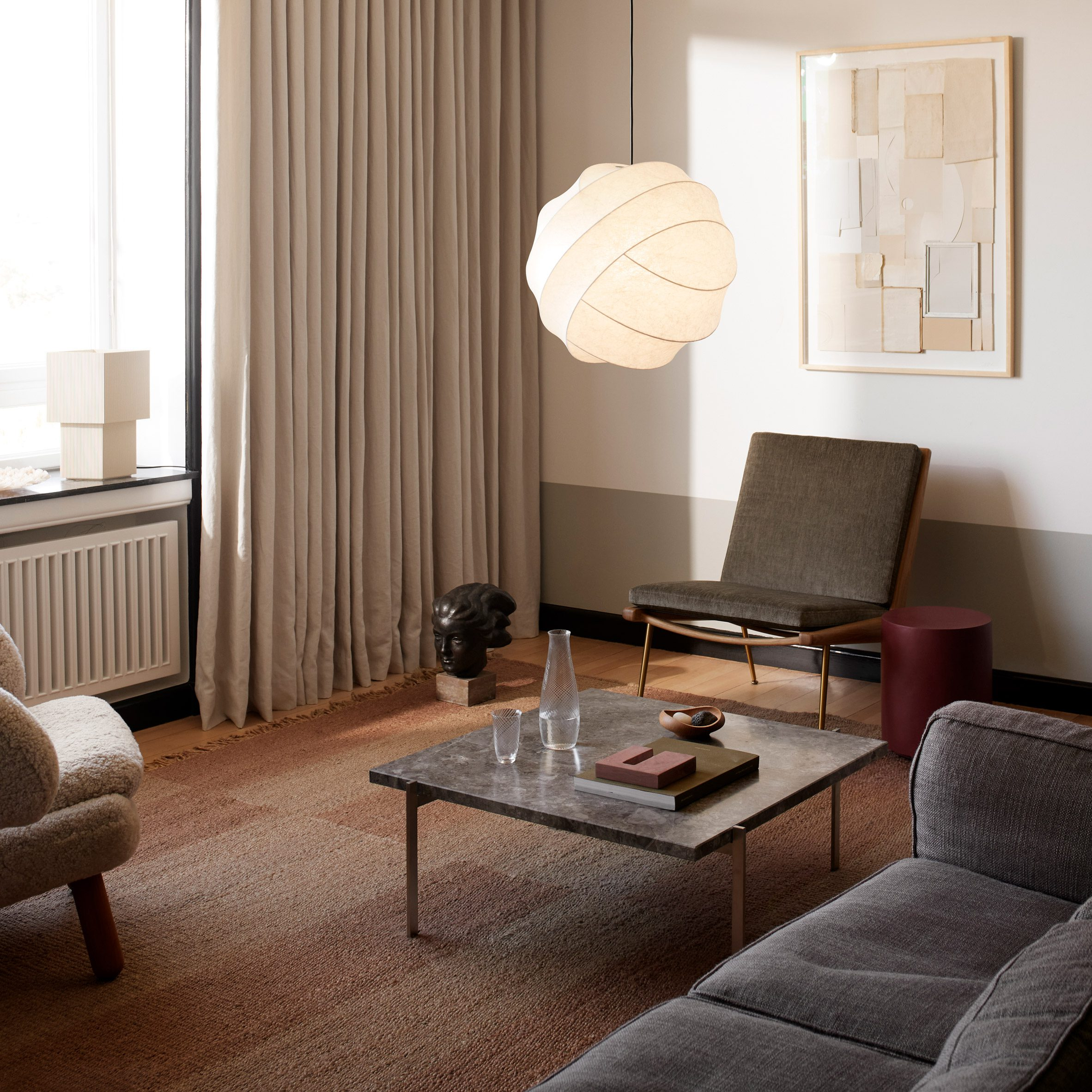 The turner pendant light hanging in a living room
