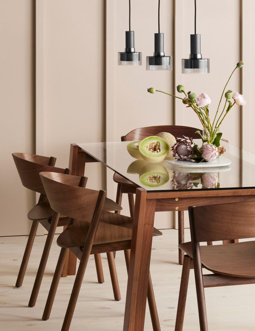 Several Port dining chairs in walnut wood around a dining table