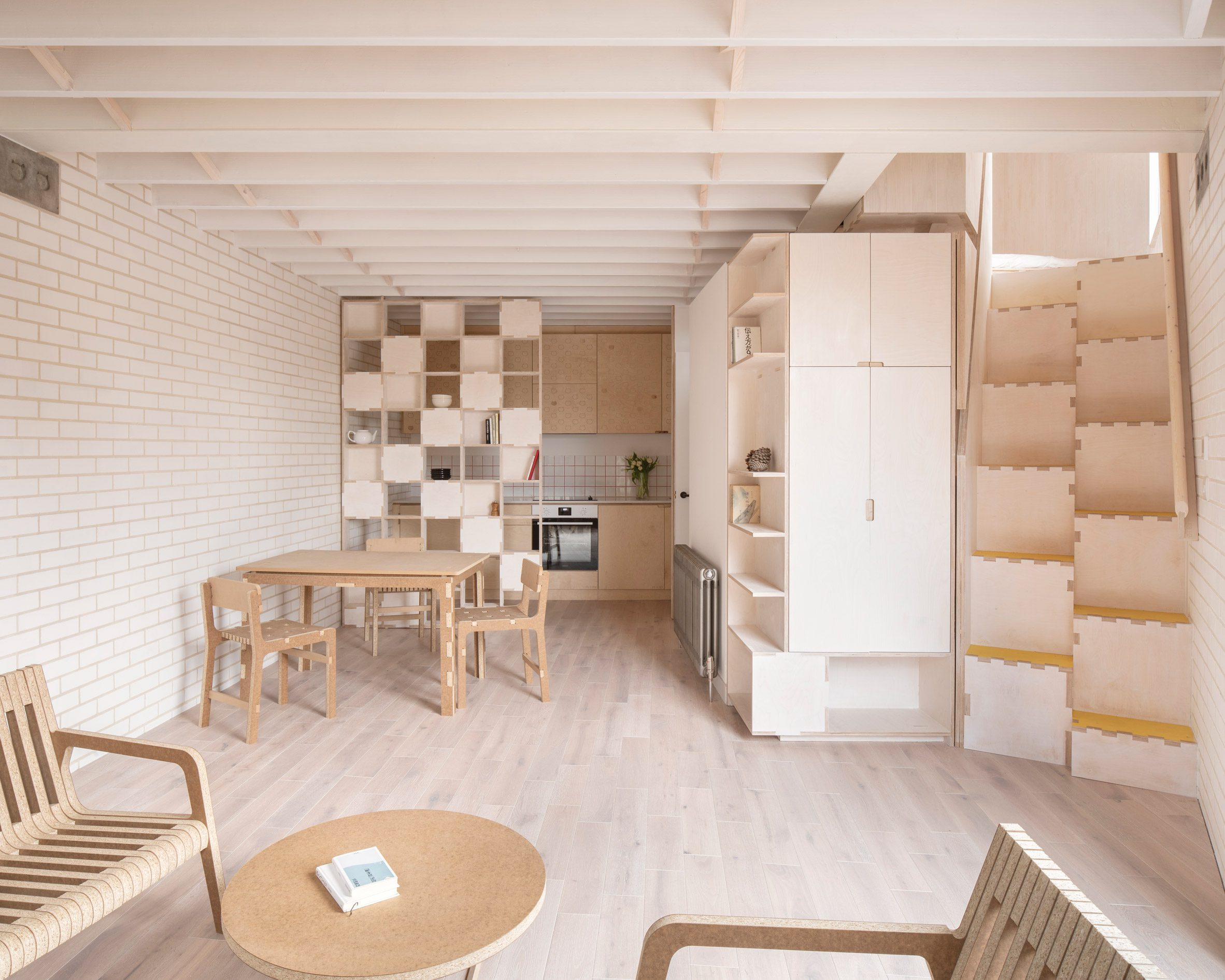 Plywood interior of a flat in The Queen of Catford by Tsuruta Architects