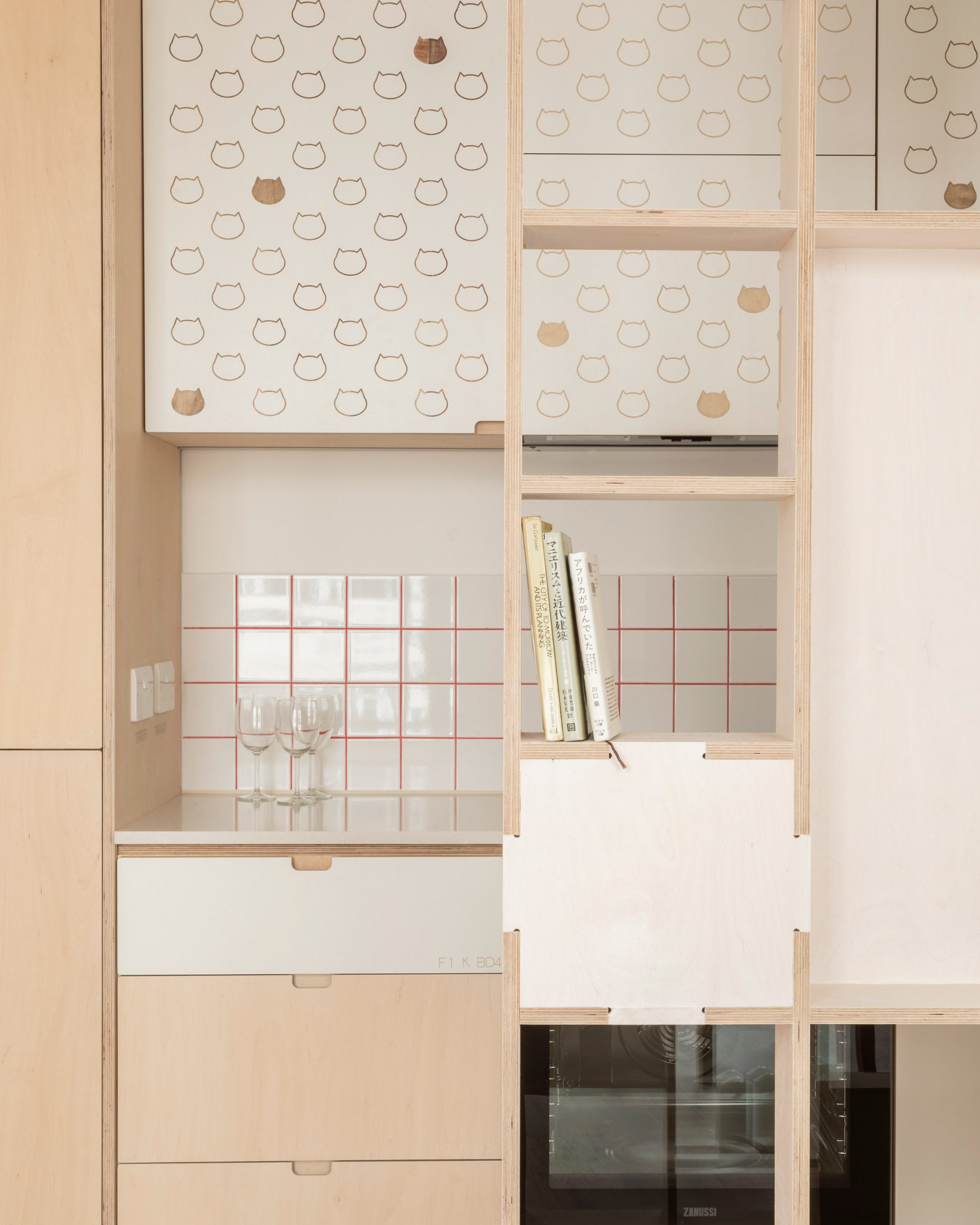 Kitchen with cat details in The Queen of Catford by Tsuruta Architects