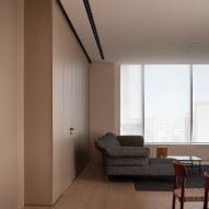 Wood-lined living room in Red Box apartment