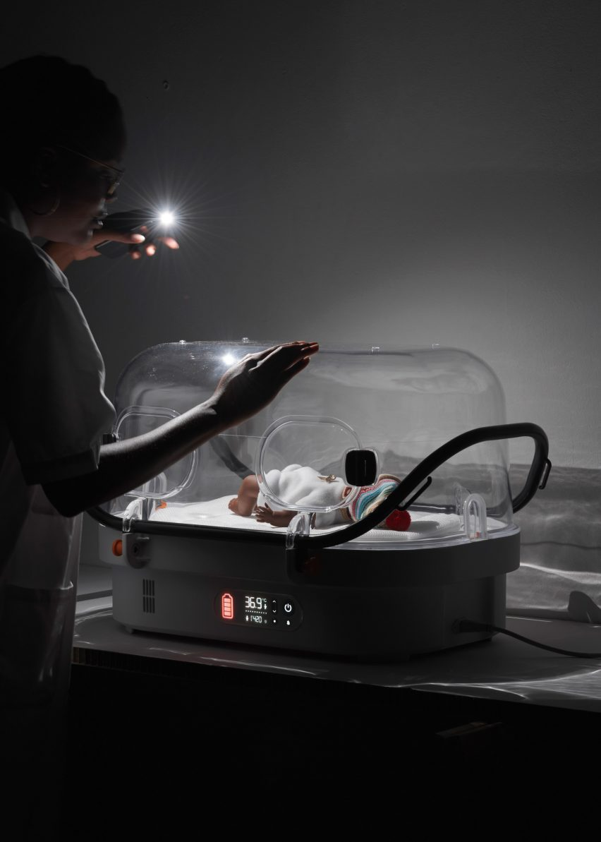 A baby sleeping inside the incubator