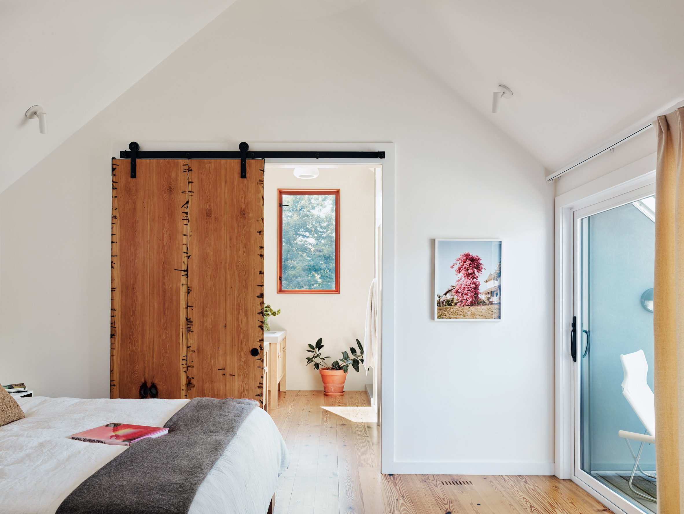 The master suite reveals the house's gabled roof