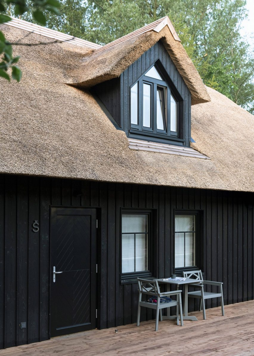 The exterior of the building was clad in charred timber and has a thatched roof