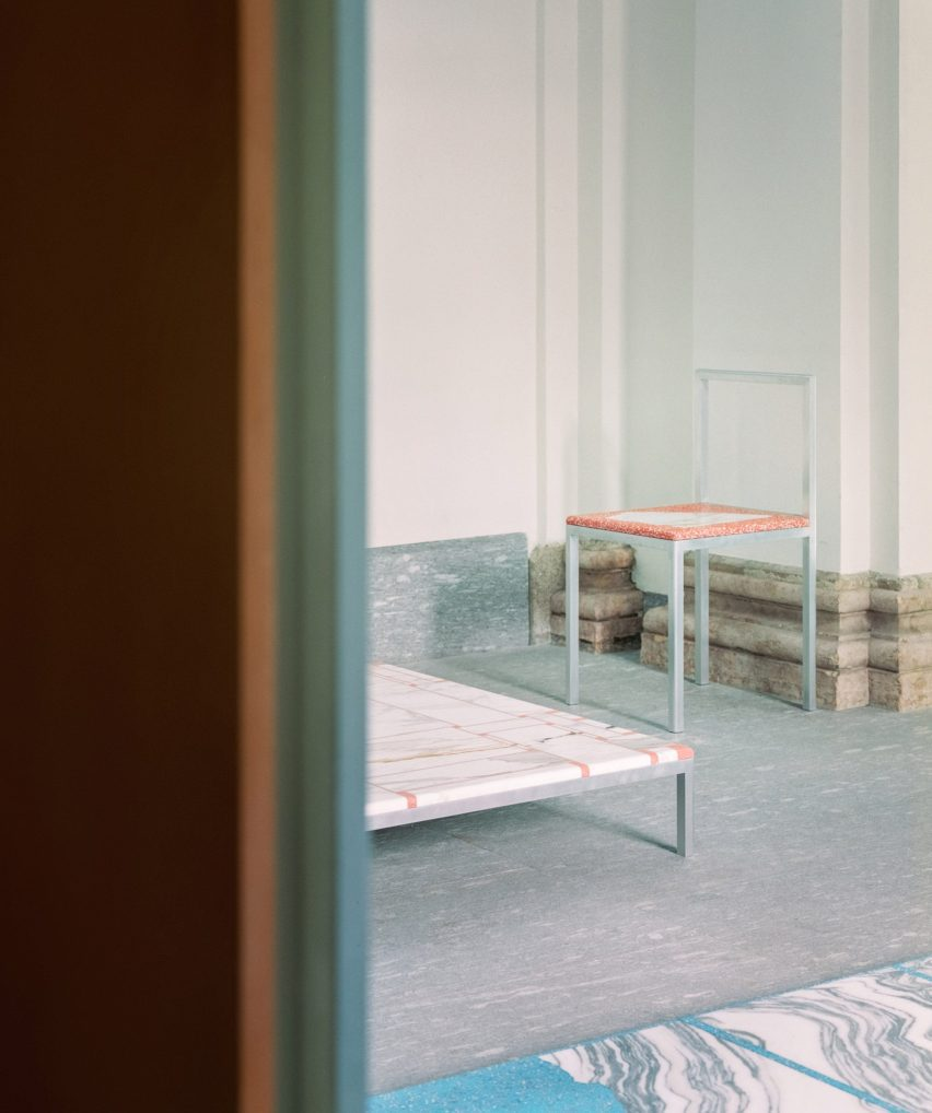 View of chair, coffee table and flooring in The Stone House exhibition