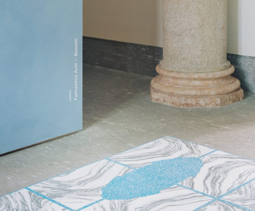 Close-up of the Stone House carpet with book-match pattern in blue and white stone