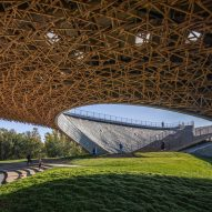 Curving roof incorporates seating at Yang Liping Performing Arts Center
