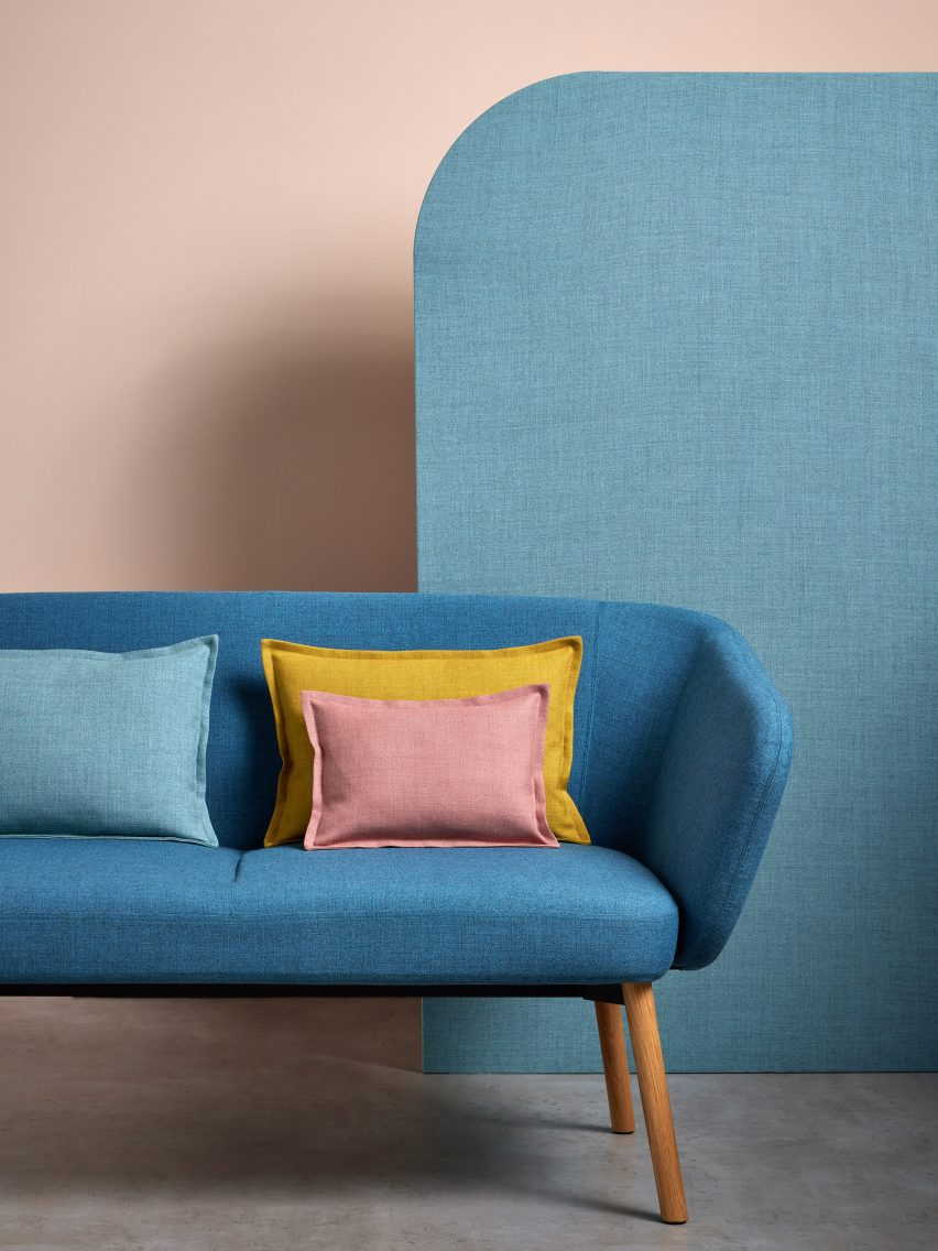 A sofa and cushions upholstered in Sumi fabric