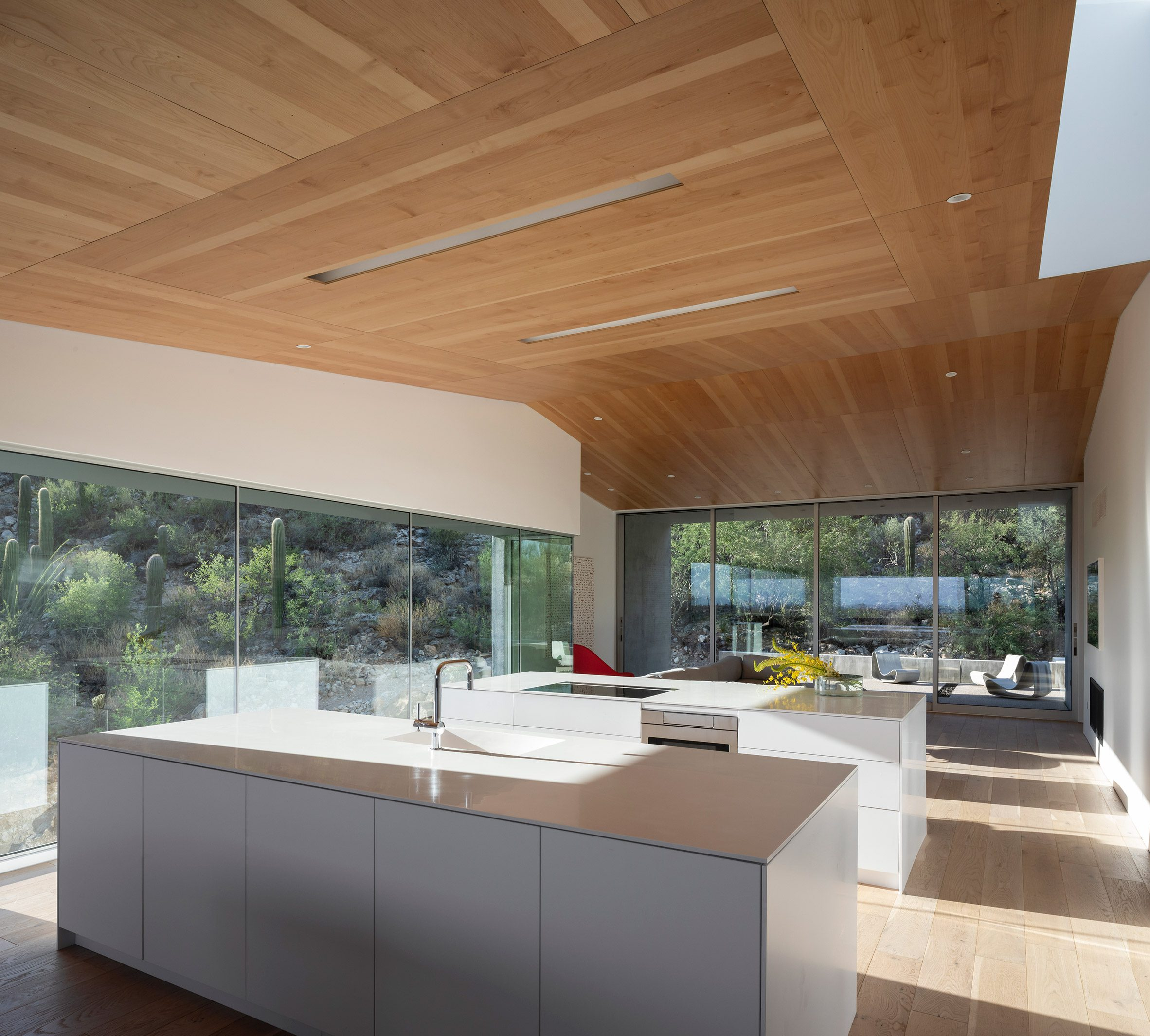 Wooden ceilings in the kitchen by HK Associates