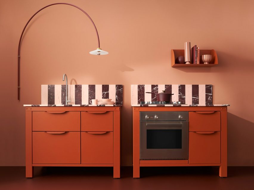Two pink and red kitchen units by Very Simple Kitchen
