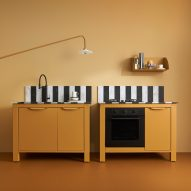 Very Simple Kitchen mixes bold colours with Italian tradition for marble and stainless steel kitchen units