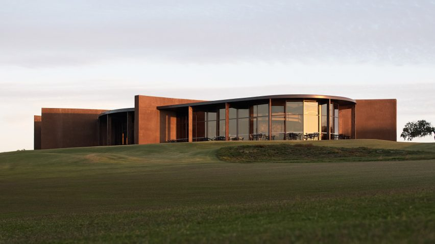 The clubhouse is pictured on top of a hill