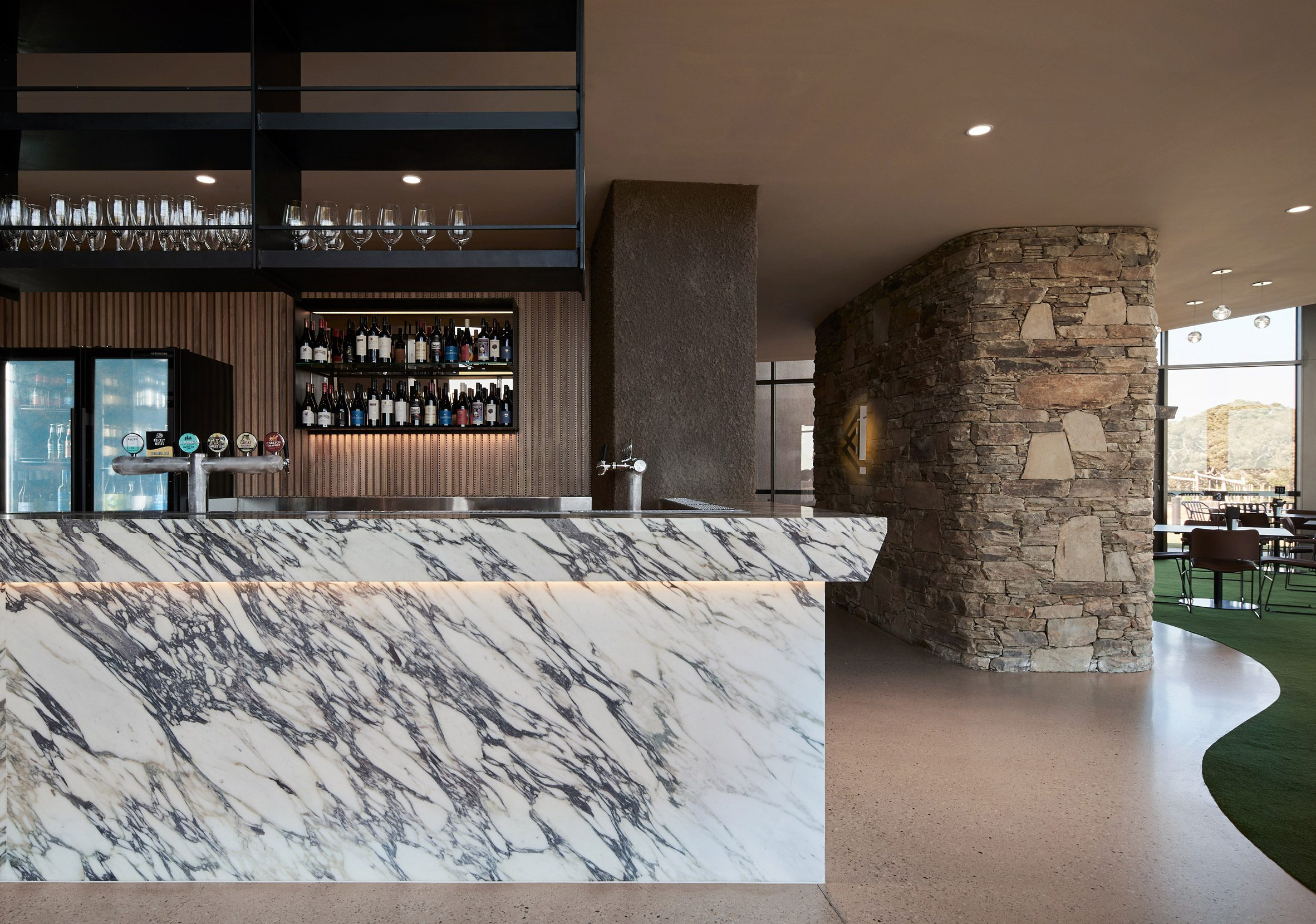 A large stone bar is located at the clubhouse