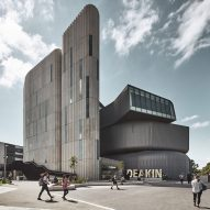 Deakin Law School by Woods Bagot features zinc cladding and fluted concrete towers