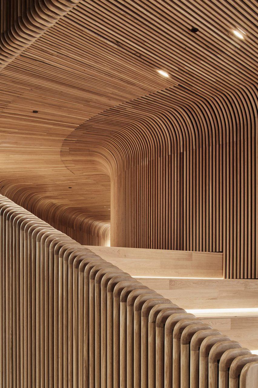 Steam-bent timber panelling in Sculptform Showroom