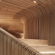 Steam-bent timber tunnels through Melbourne showroom by Woods Bagot
