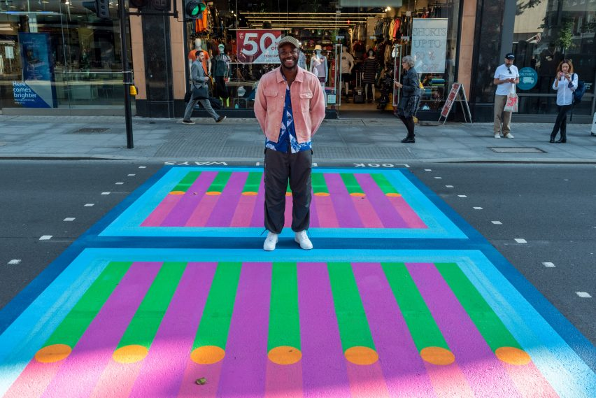 Yinka Ilori poses on his crossing for Bring London Together