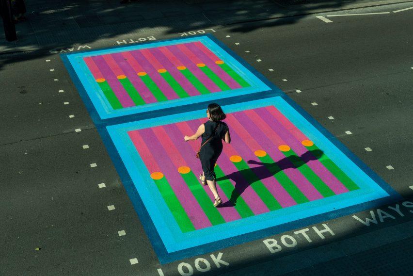 Pedestrian walking over Yinka Ilori crossings for Bring London Together