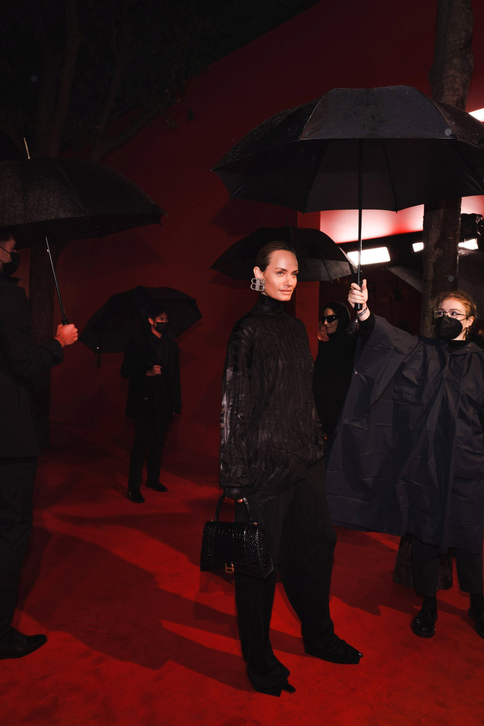 A model is covered with umbrellas at the balenciaga simspons premiere