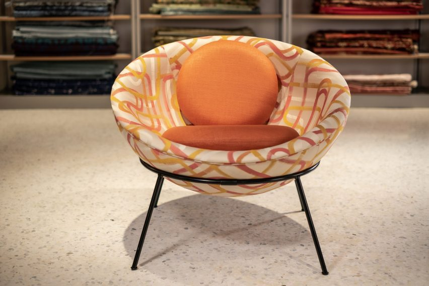 A photograph of the Bardi's Bowl Chair by Lina Bo Bardi for Arper in Lollipop fabric