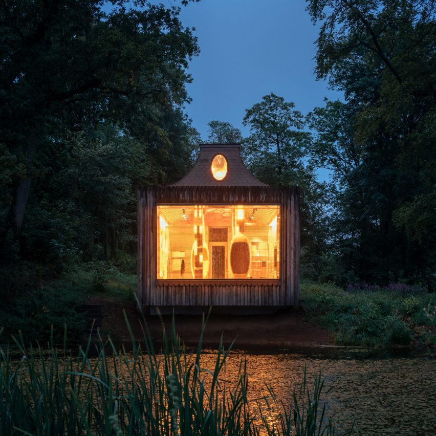 Night view across the lake for The Beezantium by Invisible Studio at The Newt in Somerset