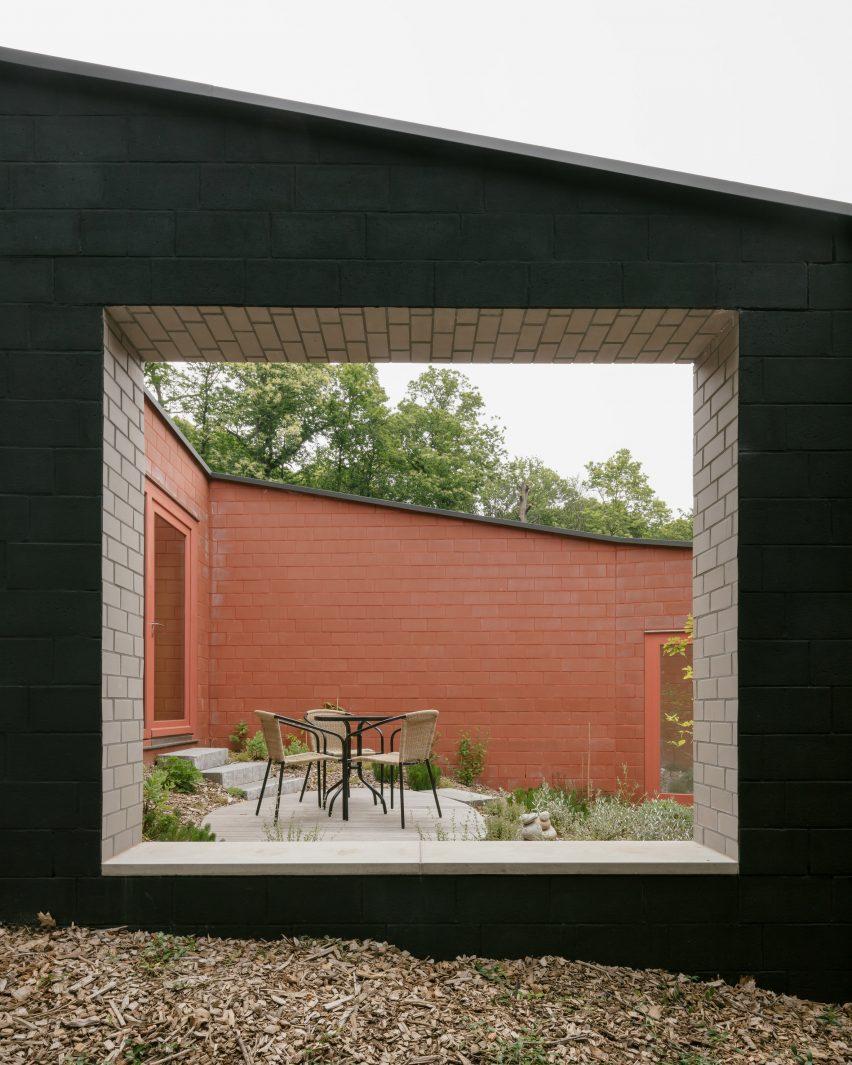 Window in black brick house