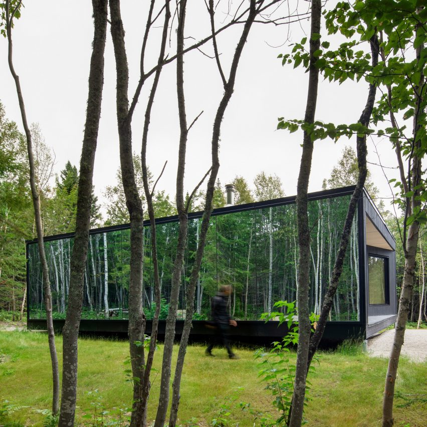 The cabin is surrounded by trees