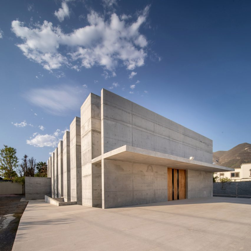 Concrete and travertine form minimalist chapel in northern Mexico by WRKSHP