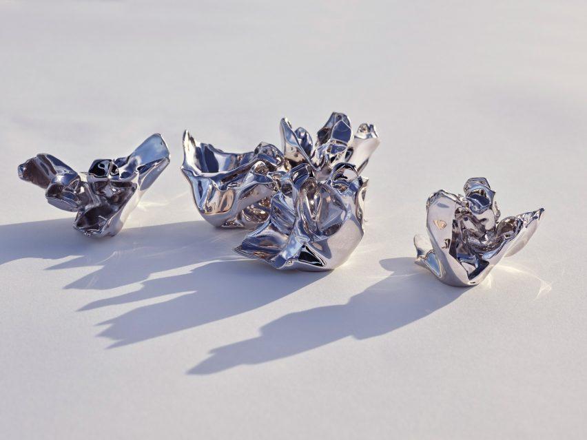 Five silver aluminium perfume bottle caps
