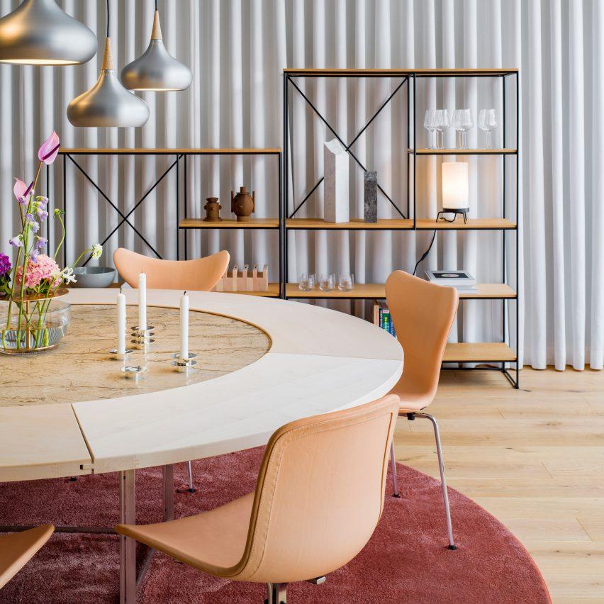 Fritz Hansen creates beige, white and rose showroom in Shanghai