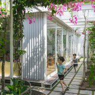 Plant-covered mesh panels surround preschool in Vietnam by HGAA