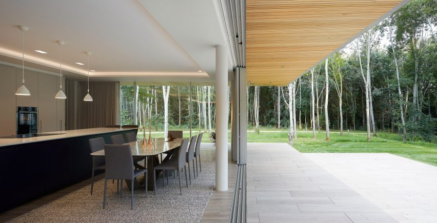Dining space in House in The Lakes by Yoo, by Broadway Malyan