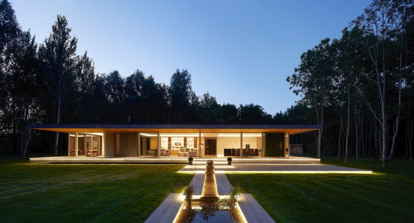 Illuminated facade of House in The Lakes by Yoo, by Broadway Malyan