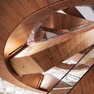 OMA adds wood-clad escalators to KaDeWe department store in Berlin