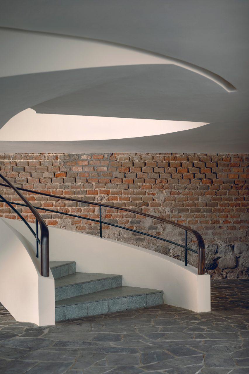 Spiral staircase and brick walls