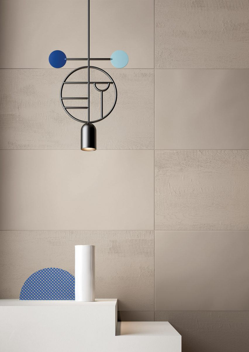 The Dune colour with the relief finish used as a wall tile, with a pendant light hanging in front of the wall