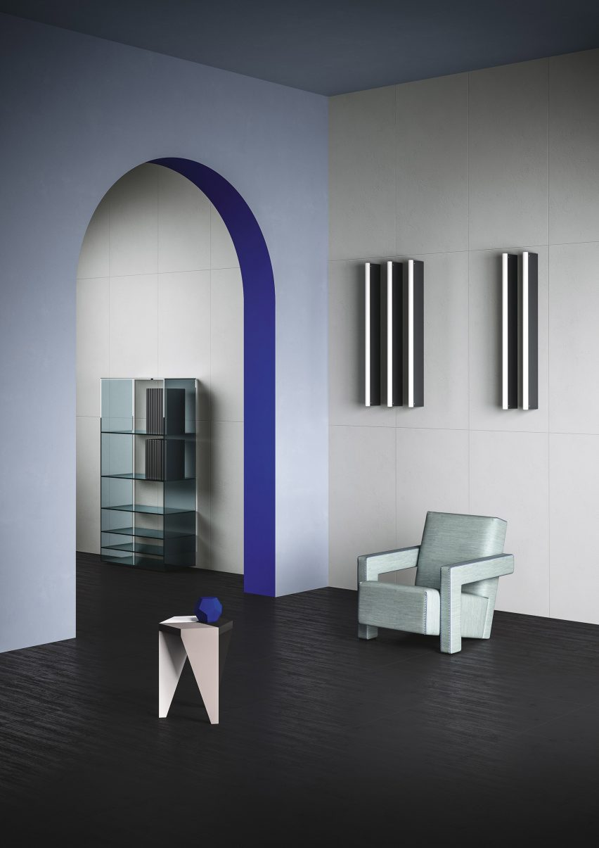 The Midnight colour tiles used as flooring and the Pearl colour used for the walls, with a light blue armchair and side table