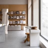 Norm Architects designs New Mags bookstore in Copenhagen to reference old libraries