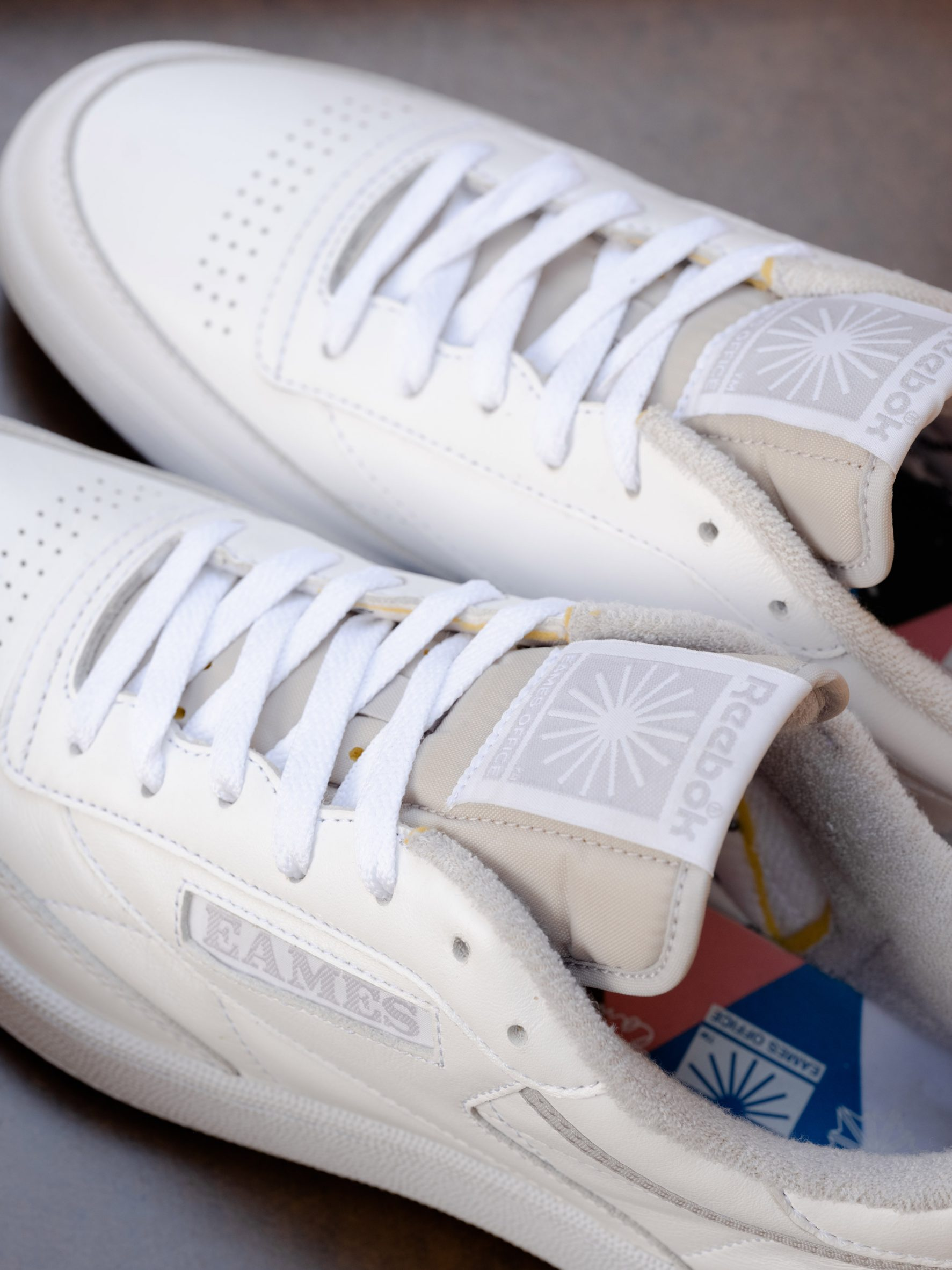A pair of white Reebok x Eames trainers