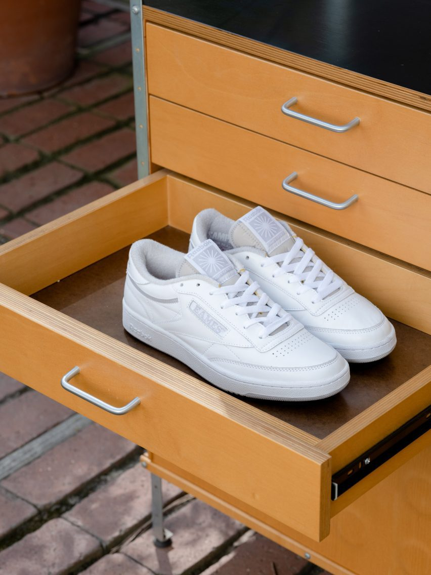 A pair of white Club C trainers in a drawer