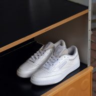 A pair of white trainers designed by Eames Office and Reebok