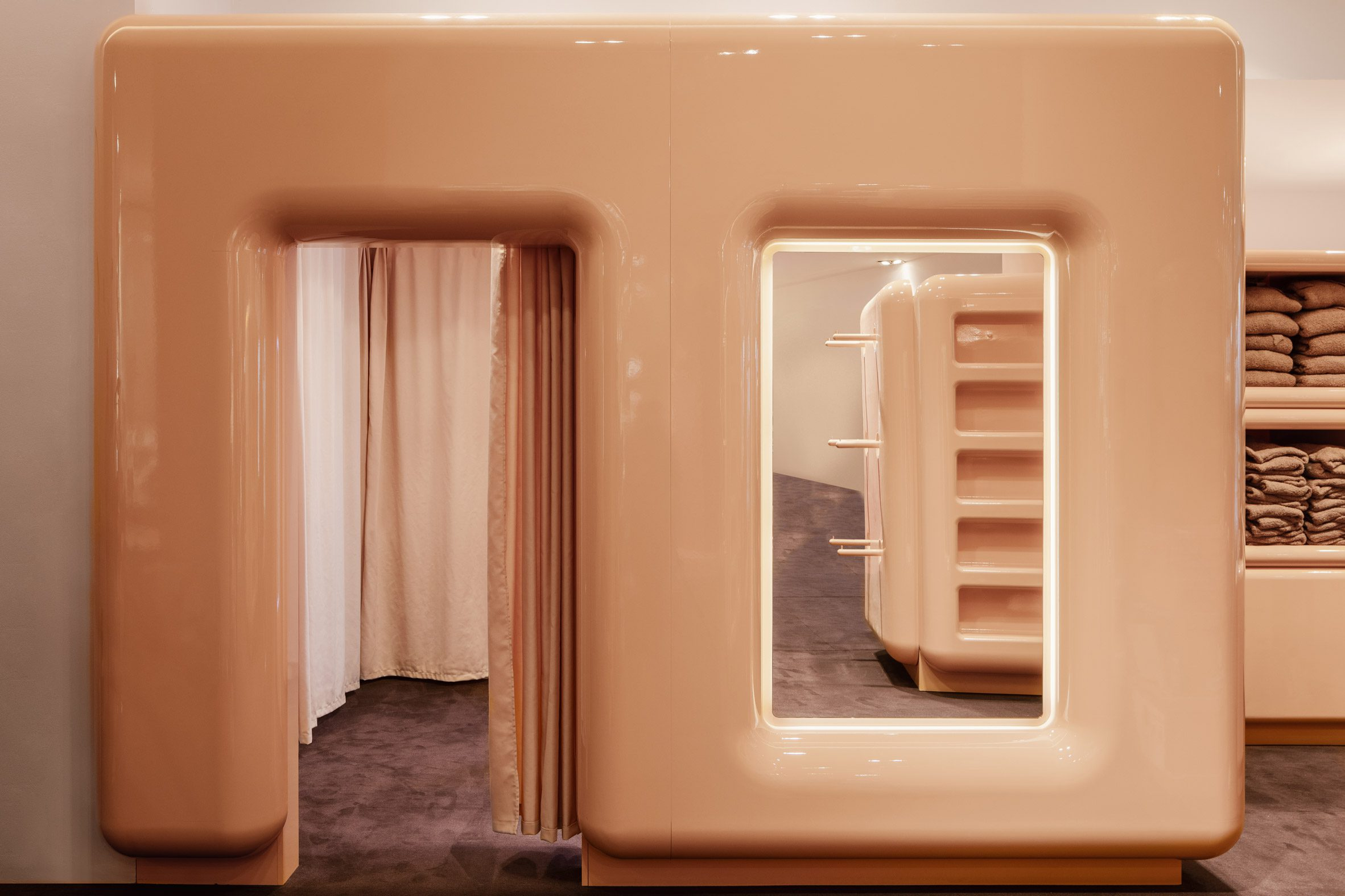 A beige doorway leading to a changing room
