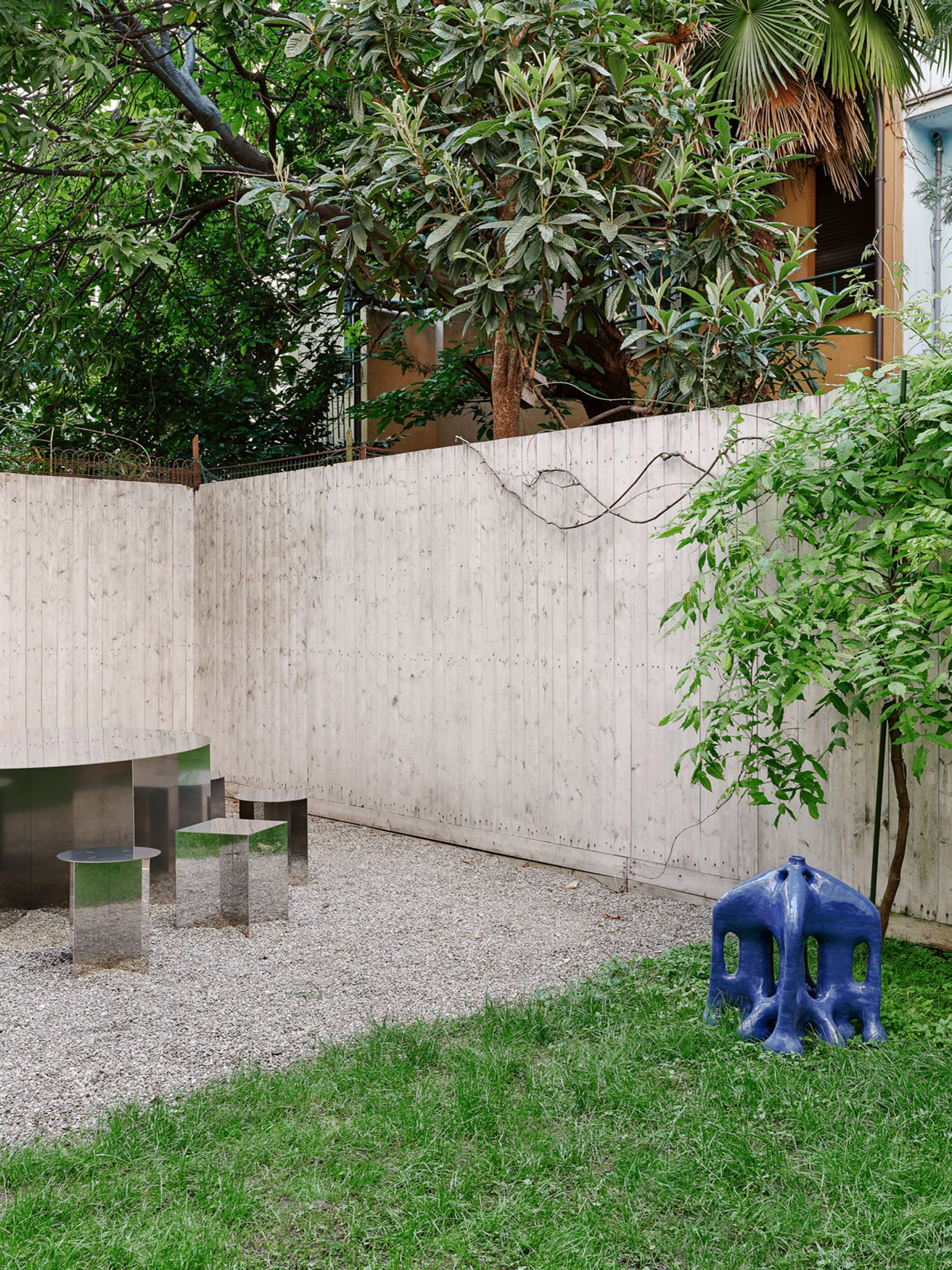 The Sunnei Palazzina courtyard includes furniture and art