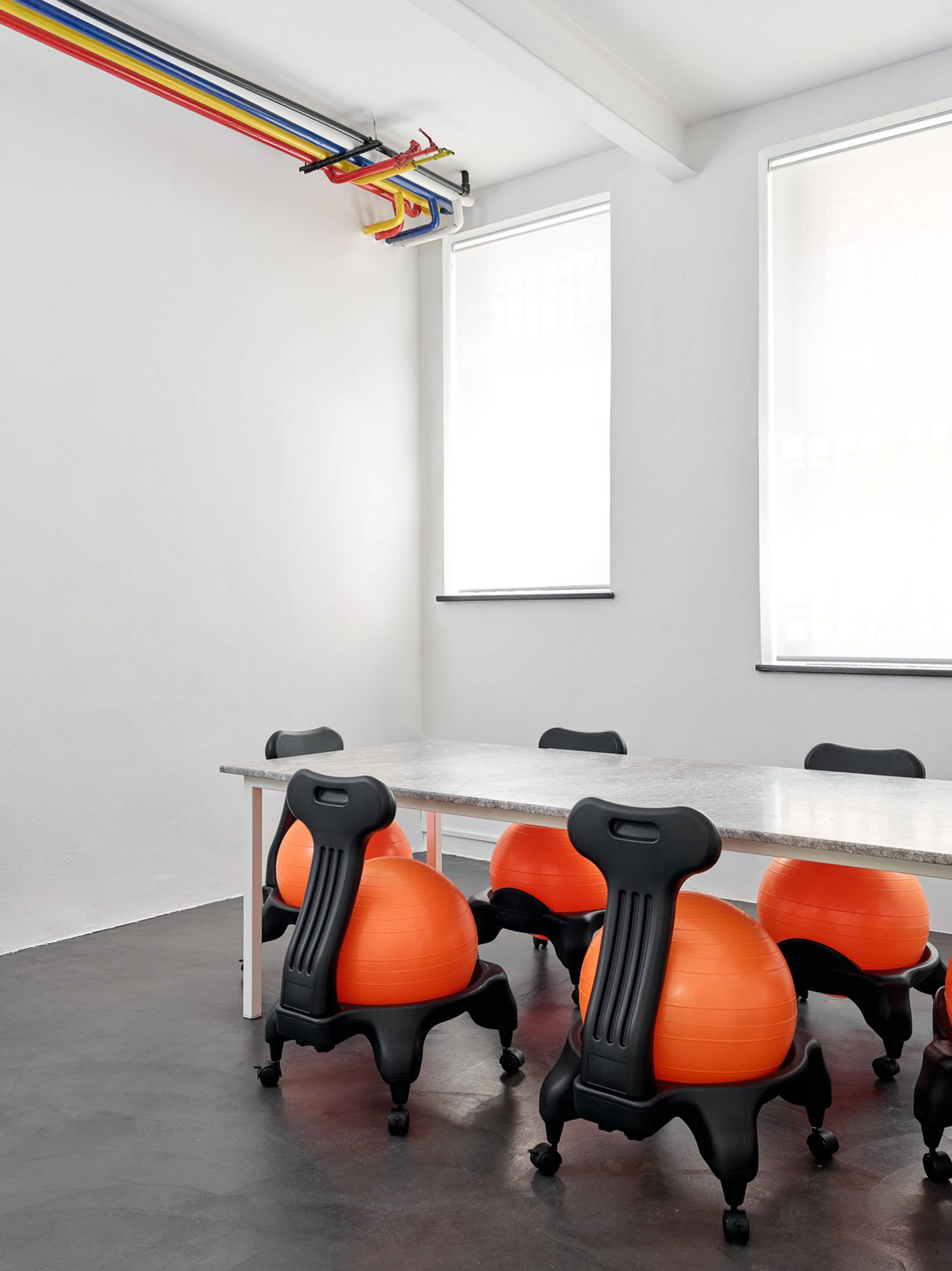 Chairs fitted with exercise balls were placed at a stone table