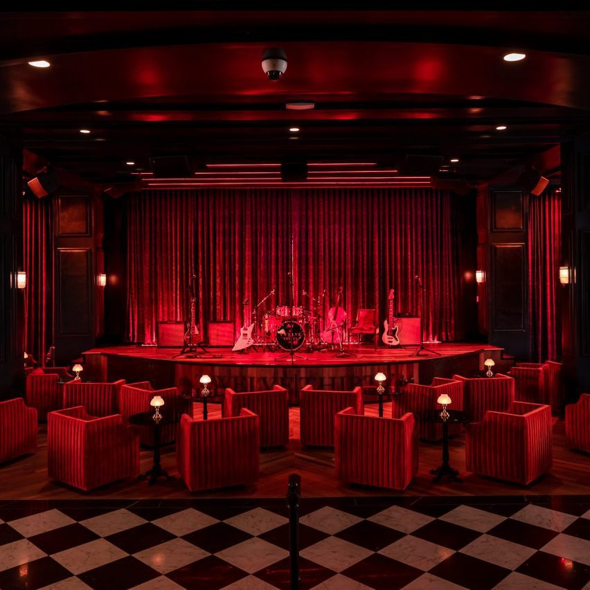A dark room with red lighting and furniture